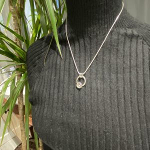 Small Oval Pendant with Double Flower